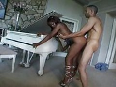 An easy black ho is bent over a piano and seen to, Ethnic Pass