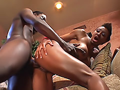 Big titted black woman has her slit opened and fucked hard